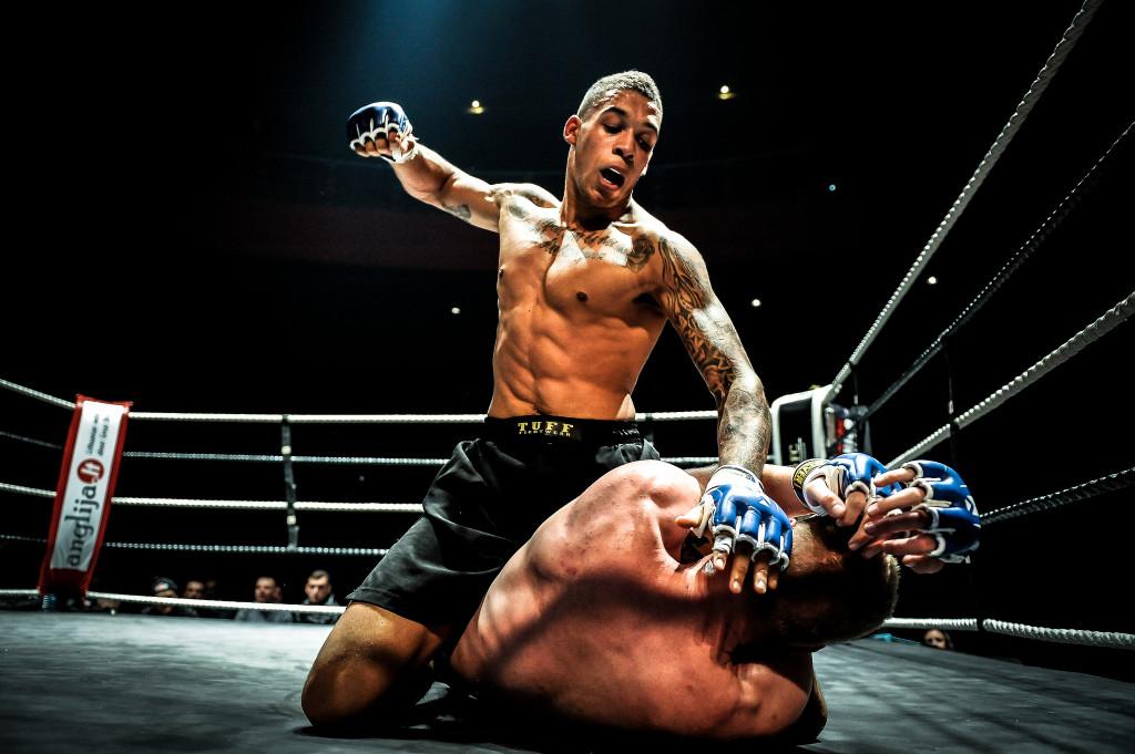mixed-martial-arts-head-blow-8236445542